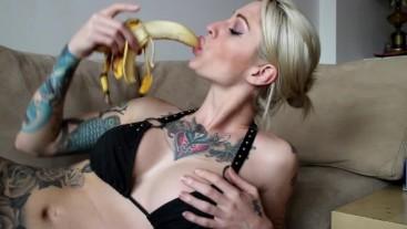 Kleio Valentien licks and sucks on banana then eats it.