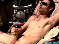 Sweet Adam Hess wanking in sunlight while lying outdoors