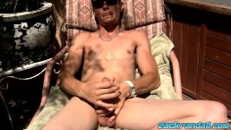 Sweet Adam Hess wanking in sunlight while lying outdoors