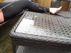 Pee on glass top table outside in the rain