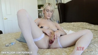 Maxim Law spreads her pussy wide