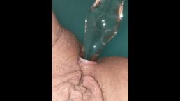 Anal play with glass in a blue bath