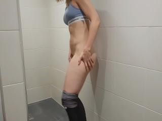 Fit girl masturbates in a gym bathroom amateur hidden camera  PetitTits