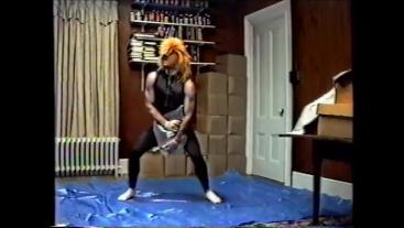 wearing black tights & crop top, stocking mask & wig hump air pillow 1990's