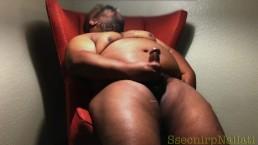 A Brown Man In A Burnt Orange Chair
