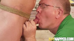 Old dominant guy strokes bound slaves cock and makes him cum