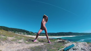 Stunning nudist girl sexy dancing naked on the coast. Perfect body