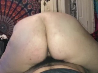 Redhead riding big dick from behind