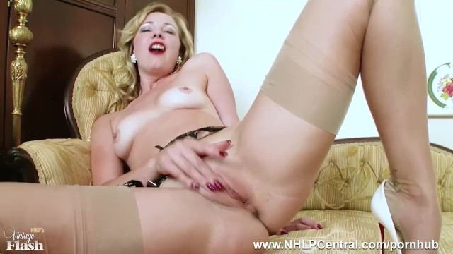 Frig xxx Tasty blonde lucy lauren frigs herself off in nylons suspenders high heels