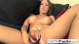 Capri gets off to playing with her wet pussy and amazing tits