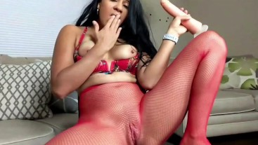 Thick Latina Jolla rips open her red stockings and rides a huge dildo