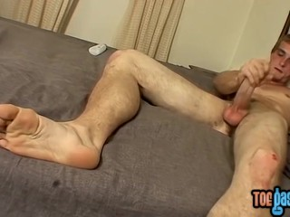 Pretty twinkie with adorable feet rubs his cock and cums