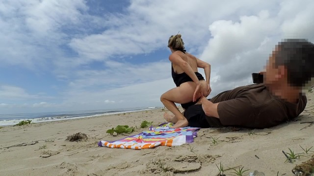 Walking around with dildo in ass More real amateur public sex risky on the beach people walking near...