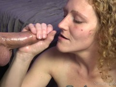 Redhead MILF Ivy sucking balls while stroking cock