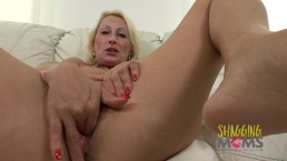 Mature woman shares a video of herself fingering her hot pussy