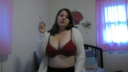 Busty girl smokes and gives a peak