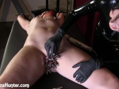 Torturing the slave girl's pussy