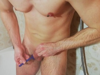 hot guy shaving his hairy cock