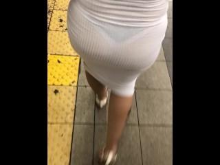 See through dress walking through crowded train station