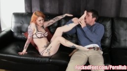 Hot Red Head Gives Footjob Under Christmas Tree for FuckedFeet!