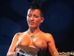 tattoed babe in a public bdasm sex show