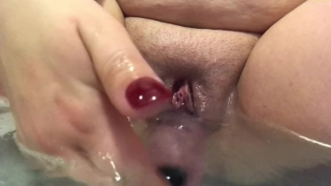 Wet and slippery bath time dildo