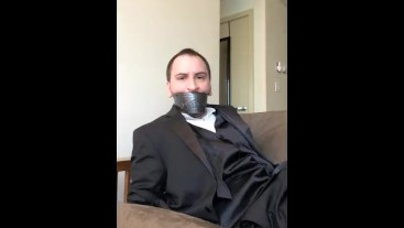 Handcuffed and Tapegagged in a Tuxedo