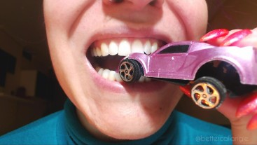 Chewed and smashed poor toy car, totally broken into pieces with my teeth