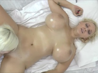 Busty blonde enjoys oil massage by an old woman