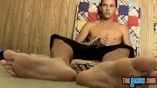 Skinny dude rubs his cock and feet at the same time solo Cum tattoo