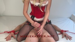 Blonde babe in corset and stockings gives Christmas Handjob - Marie Kaefer
