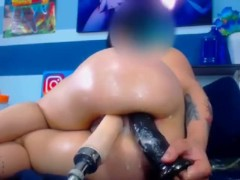 the girl moans loudly from the fuck machine and a huge black dick in anal