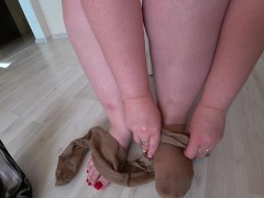 Thick legs wear nylon tights and elegant heeled shoes, foot fetish.
