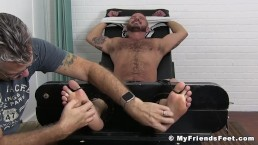 Inked Sean Harding restrained by mature tickler