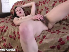 Skinny Liza James touches her hairy pussy