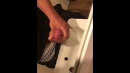 Brad Newman strokes his cock in a bar bathroom