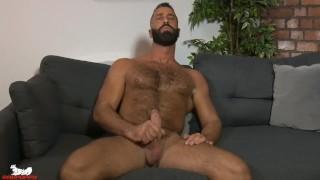 Greek stud Lex Anders tweaks his nipples while jacking his cock
