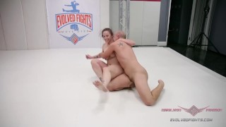 Busty Redhead Bella Rossi wants on the wrestling mat