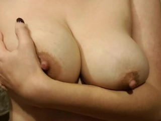 Taking off thin white bra to reveal huge...