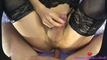 Transsexual in lingerie sucking cock close up
