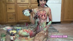 Kinky cutie Sophia is in the kitchen and covering her body with cream