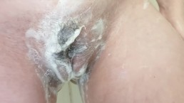 Rubbing my swollen pussy in the shower