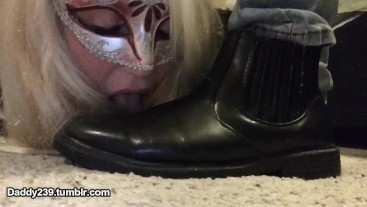 slave cleans her Masters boots with her tongue