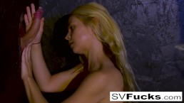 Sexy Blonde Sarah swallows a big cock in a Glory Hole