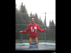 Teen shows his big cock for fun on a trampoline at the camp
