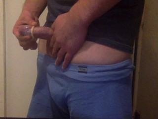 Cock putting on a condom...