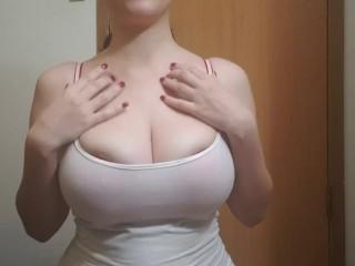 Huge natural boobs busting out bra...