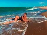Stunning nudist girl having fun on the public beaches of Valencia