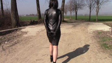 A walk in leather dress and handcuffs, part 2 Handcuffs behind back