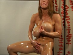 Busty Bodybuilder Oil Bath